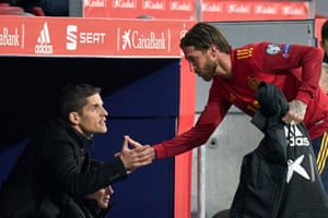 Robert Moreno shakes hands with Sergio Ramos during the Euro 2020 qualifier against Romania.
