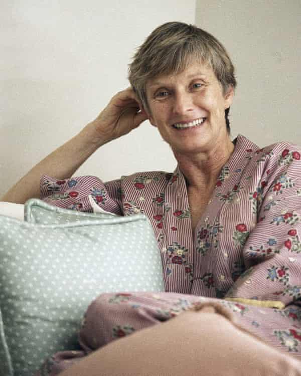 Cloris Leachman sitting on a sofa resting her head on one hand