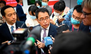 Yin Weidong answering questions from journalists in September.