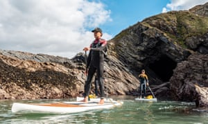 Paddlers exploring rugged cave