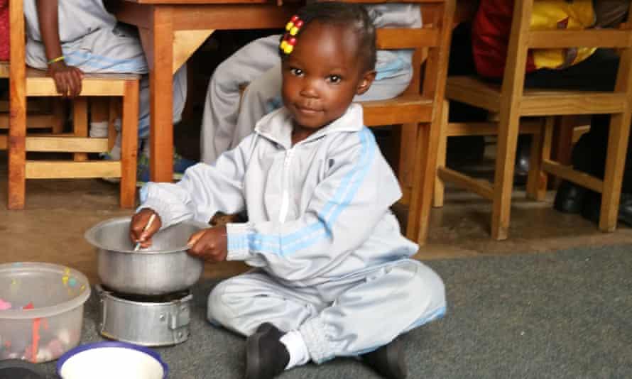 Joy plays in her nursery in Kibera, Nairobi.