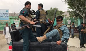 Afghan police officers on the back of a truck