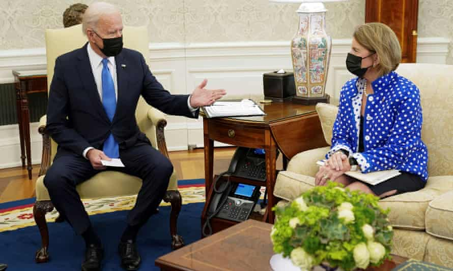 Joe Biden gestures toward Senator Shelley Capito during an infrastructure meeting at the White House.