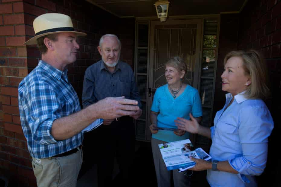 Christopher Pyne door-knocking in the South Australian state seat of Torrens with the Liberal candidate Therese Kenny. They are talking to Don and Dawn Goldney.