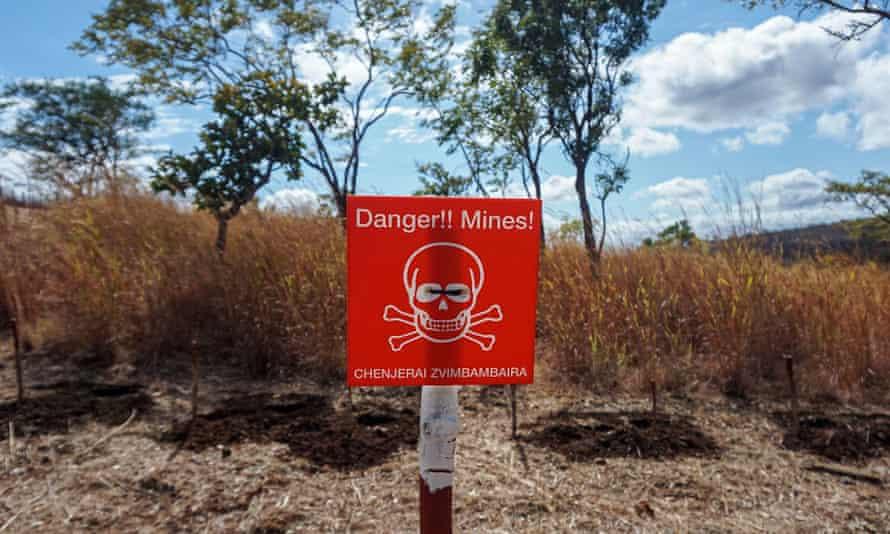 A sign in English and Shona warns of landmines in Rushinga, Zimbabwe.