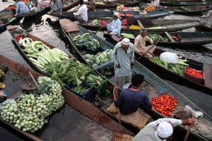 Srinagar, India. A floating vegetable market on Dal Lake, which is home to floating gardens that produce vegetables in all four seasons of the year