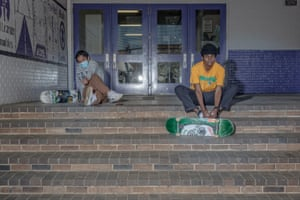 Skateboarders stretch before skating at a local high school in Queens, New York on April 25th. Photo by Jordan Gale