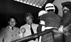 England captain Bobby Moore, in white shirt, leaves the Fuego Verde jewellery shop, in Bogotá, where it was claimed he had stolen a bracelet.