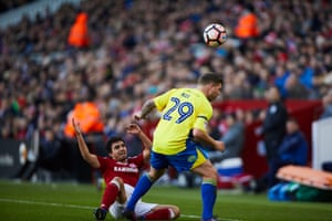 Middlesbrough's defender Fabio Da Silva is left on the floor as Billy Kee shrugs him off the ball.