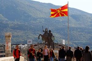 People pass over the stone bridge in Skopje, North Macedonia April 19, 2019. REUTERS/Ognen Teofilovski