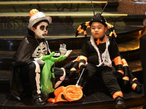 Filipino boys wear costumes along a staircase as they join a Halloween celebration at a hotel in Manila, Philippines