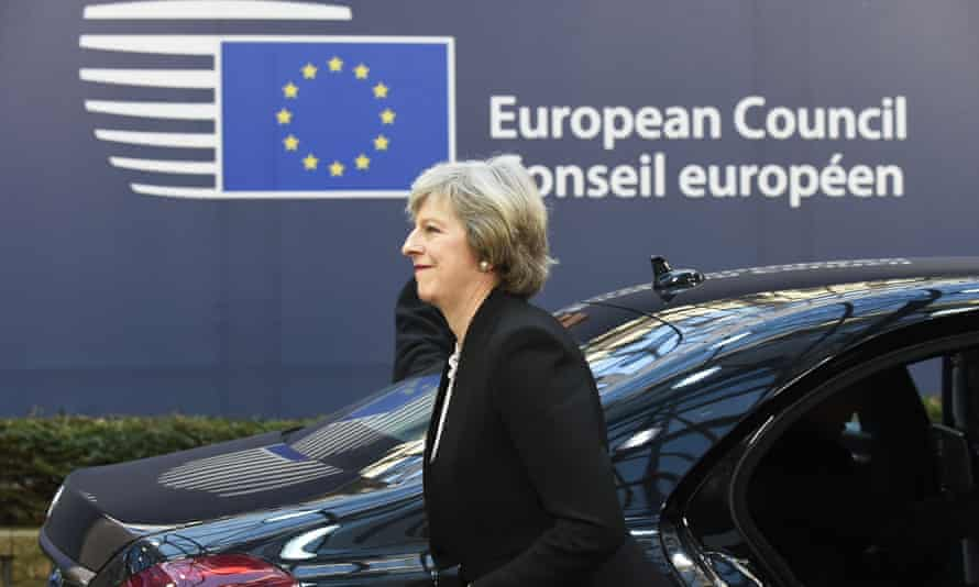 Theresa May arrives for a European council summit.