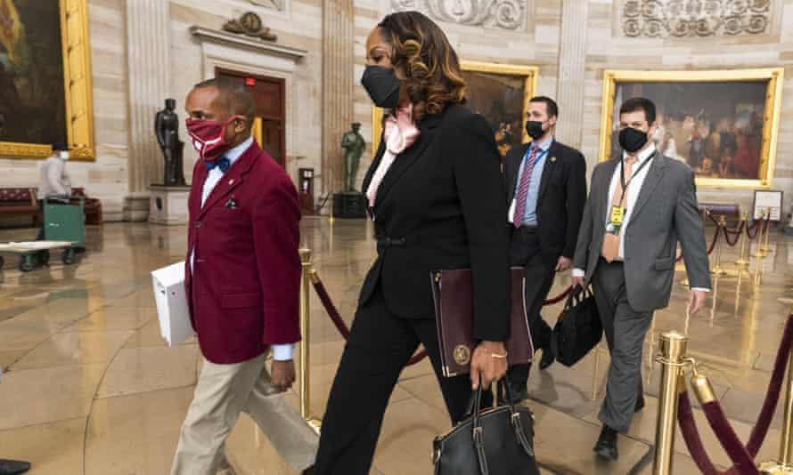 Stacey Plaskett walks through the Capitol Rotunda to the Senate.