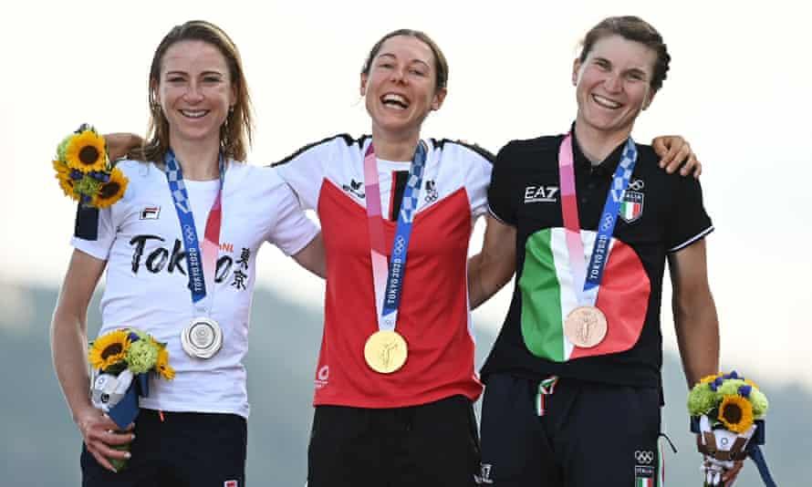 Anna Kiesenhofer of Austria is flanked by Annemiek van Vleuten of the Netherlands (left) and Elisa Longo Borghini of Italy on the podium.