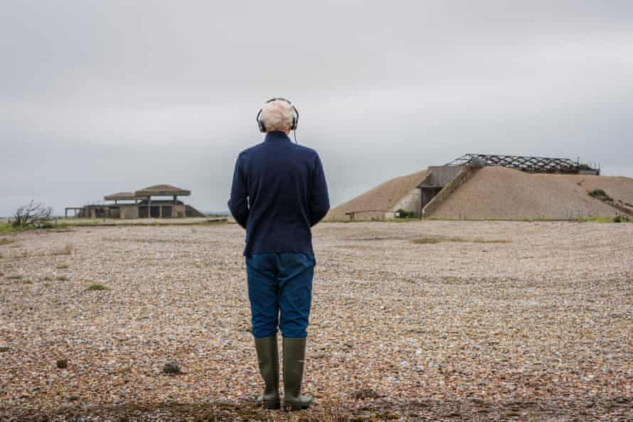 A visitor experiencing Ilya Kaminsky's sound walk, I See a Silence (2021) in Orford Ness, Suffolk.