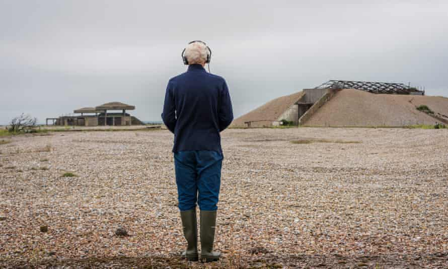 A visitor experiencing Ilya Kaminsky's sound walk, I See a Silence (2021) on Orford Ness, Suffolk.