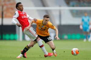 Jota of Wolves tussles with Arenal's Joe Willock.