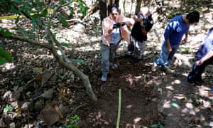 A forensic team works at the village of El Mozote amid a search for bodies.