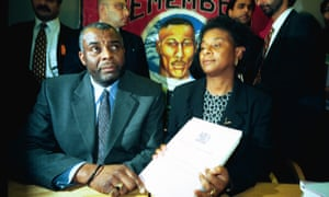 Neville and Doreen Lawrence with the inquiry report into the murder of their son, Stephen. The scandal led to major changes in British policing.