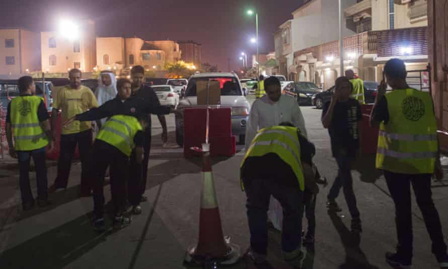 Saudi Shia worshipers being searched by volunteer security guards