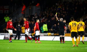 Victor Lindelof is relieved to see that it is finally the yellow card that referee Martin Atkinson is waving in his direction.