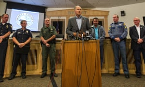 Washington governor Jay Inslee, flanked by local law enforcement that detained suspect Arcan Cetin. Terrorism is not a suspected motive for the shooting, says the FBI.