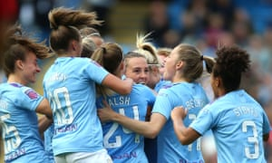 Manchester City's Caroline Weir is mobbed by teammates after scoring the winner in the derby against United