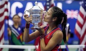 Emma Raducanu kisses the US Open championship trophy after defeating Leylah Fernandez.