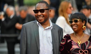 Malian singers Amadou Bagayoko (L) and Mariam Doumbia pose as they arrive on May 25, 2017 for the screening of the tv series 'Twin Peaks' at the 70th edition of the Cannes Film Festival in Cannes, southern France
