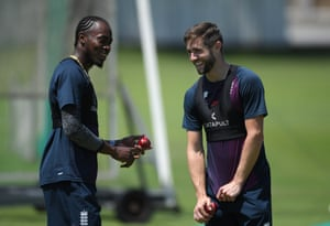 Jofra Archer and Chris Woakes share a joke during England nets