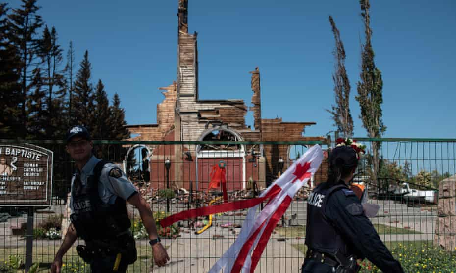 Firefighters inspect the damage at the burned-out Roman Catholic St Jean Baptiste church in Morinville, Alberta, Canada.
