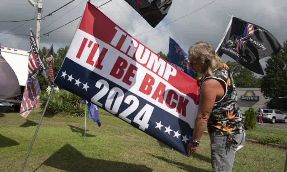 Unofficial campaign flags and buttons for Donald Trump are consistent sellers at a roadside vendor tent in northern Alabama, where the former president drew a crowd of several thousand supporters last month.