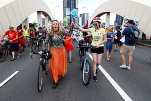Protesters march during an Extinction Rebellion rally from Kurilpa Park to William Jolly Bridge in Brisbane, Australia