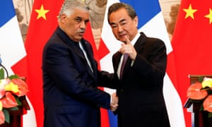 The Dominican Republic's foreign minister, Miguel Vargas (left), shakes hands with his Chinese counterpart, Wang Yi, in Beijing.