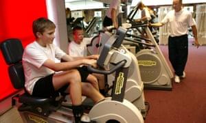 Boys using gym equipment