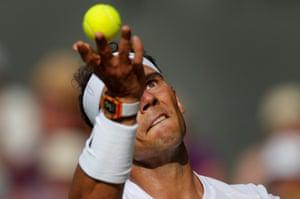 Rafael Nadal serves during his straight sets win over Karen Khachenov on Centre Court