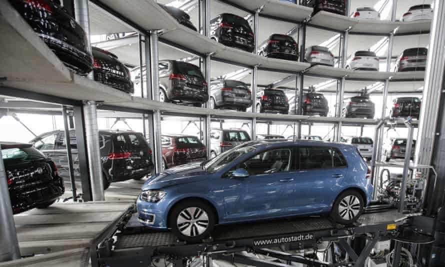A Volkswagen Golf makes its way through a delivery tower at the company's Wolfsburg headquarters.