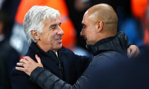 Manchester City's Pep Guardiola (right) embraces his Atalanta counterpart Gian Piero Gasperini before their Champions League game in October 2019.