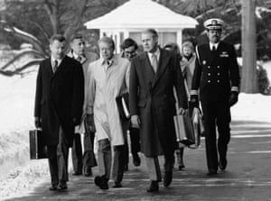 President Jimmy Carter, flanked by secretary of state Cyrus Vance, right, and Zbigniew Brzezinski, left.