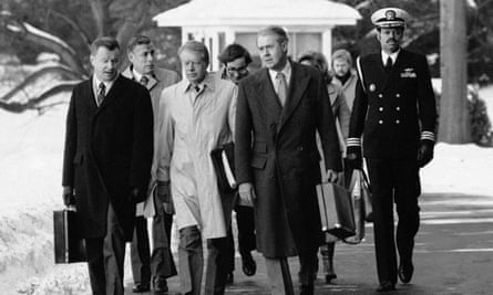 Zbigniew Brzezinski, left, with Jimmy Carter, centre in raincoat, and Cyrus Vance in 1979.