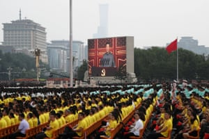 Chinese President Xi Jinping is seen on a giant screen as he delivers a speech at the event marking the 100th founding anniversary of the Communist Party of China, on Tiananmen Square in Beijing, China July 1, 2021.