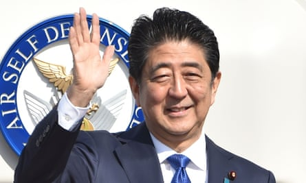 Shinzo Abe waves to wellwishers before boarding a plane for America.