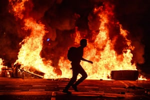 Fires burn after an evening of rioting in Barcelona, Spain