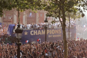 The French World Cup champions parade in an open bus in front of cheering crowds on the Champs Élysées