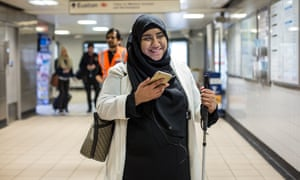 Wayfindr technology helps a visually impaired woman navigate London's Euston station.