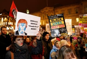 Edinburgh, Scotland Demonstrators hold up banners protesting Trump's presidency