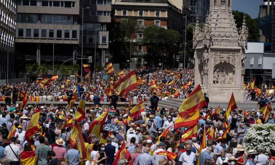 People wave Spanish flags during a protest in Madrid  by rightwing protesters