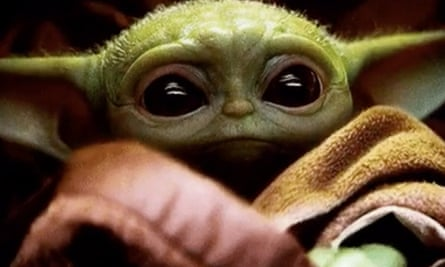 The shiniest non-human babysitting service going... Baby Yoda from The Mandalorian on Disney+.