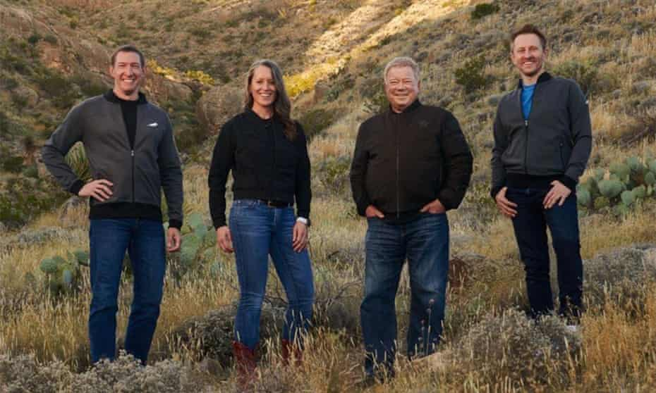 """US-SPACE-BLUE ORIGIN-SHATNER<br>This handout photo released by Blue Origin Media on October 12, 2021 shows the four member Blue Origin crew (from R) Chris Boshuizen, Canadian actor William Shatner, Audrey Powers and Glen de Vries posing at an undisclosed location. - Blue Origin announced on October 10 that it was delaying its flight set to carry actor William Shatner to space due to anticipated winds. The new flight is scheduled for October 13. (Photo by - / BLUE ORIGIN / AFP) / RESTRICTED TO EDITORIAL USE - MANDATORY CREDIT """"AFP PHOTO / BLUE ORIGIN """" - NO MARKETING - NO ADVERTISING CAMPAIGNS - DISTRIBUTED AS A SERVICE TO CLIENTS (Photo by -/BLUE ORIGIN/AFP via Getty Images)"""
