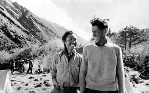 Sir Edmund Hillary (R) and Sherpa Tenzing Norgay smile after their ascent of Mount Everest.